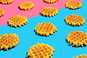 Waffles on colourful background